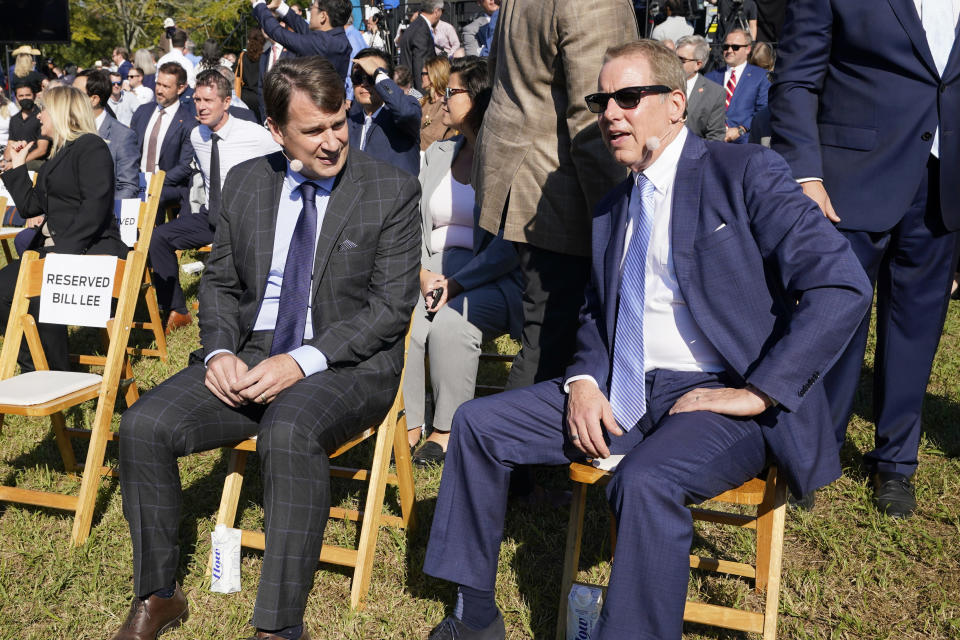 Jim Farley, Ford president and CEO, left, and Ford Executive Chairman Bill Ford, right, talk before a presentation on the planned factory to build electric F-Series trucks and the batteries to power future electric Ford and Lincoln vehicles Tuesday, Sept. 28, 2021, in Memphis, Tenn. The plant in Tennessee is to be built near Stanton, Tenn. (AP Photo/Mark Humphrey)