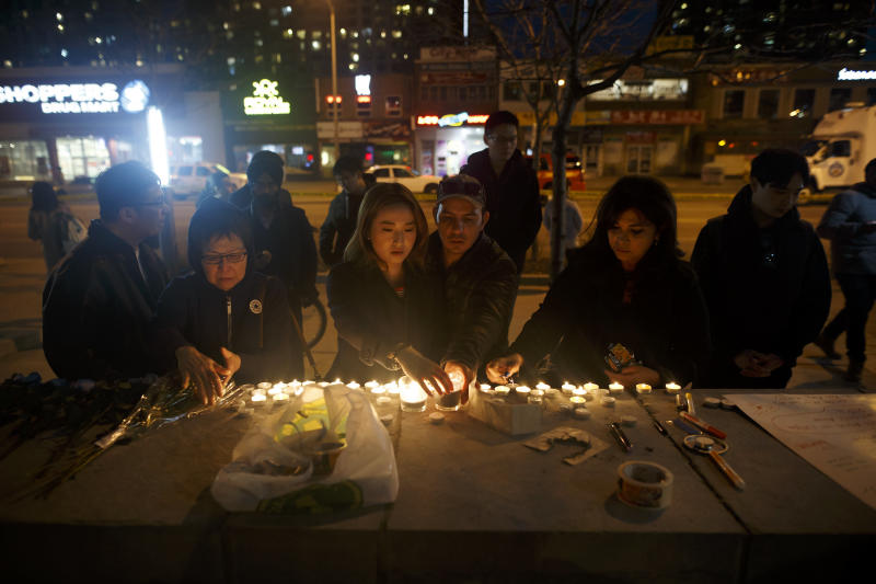 People left candles and messages at a memorial for victims of a crash late Monday. (Cole Burston via Getty Images)