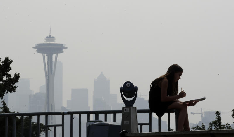 A photo shows thesmoky haze that obscured the Space Needle and downtown Seattle in August 2018. (ASSOCIATED PRESS)