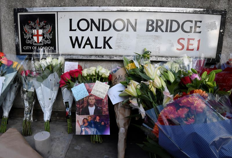 Messages of condolence and floral tributes are seen near the scene of a stabbing on London Bridge, in London
