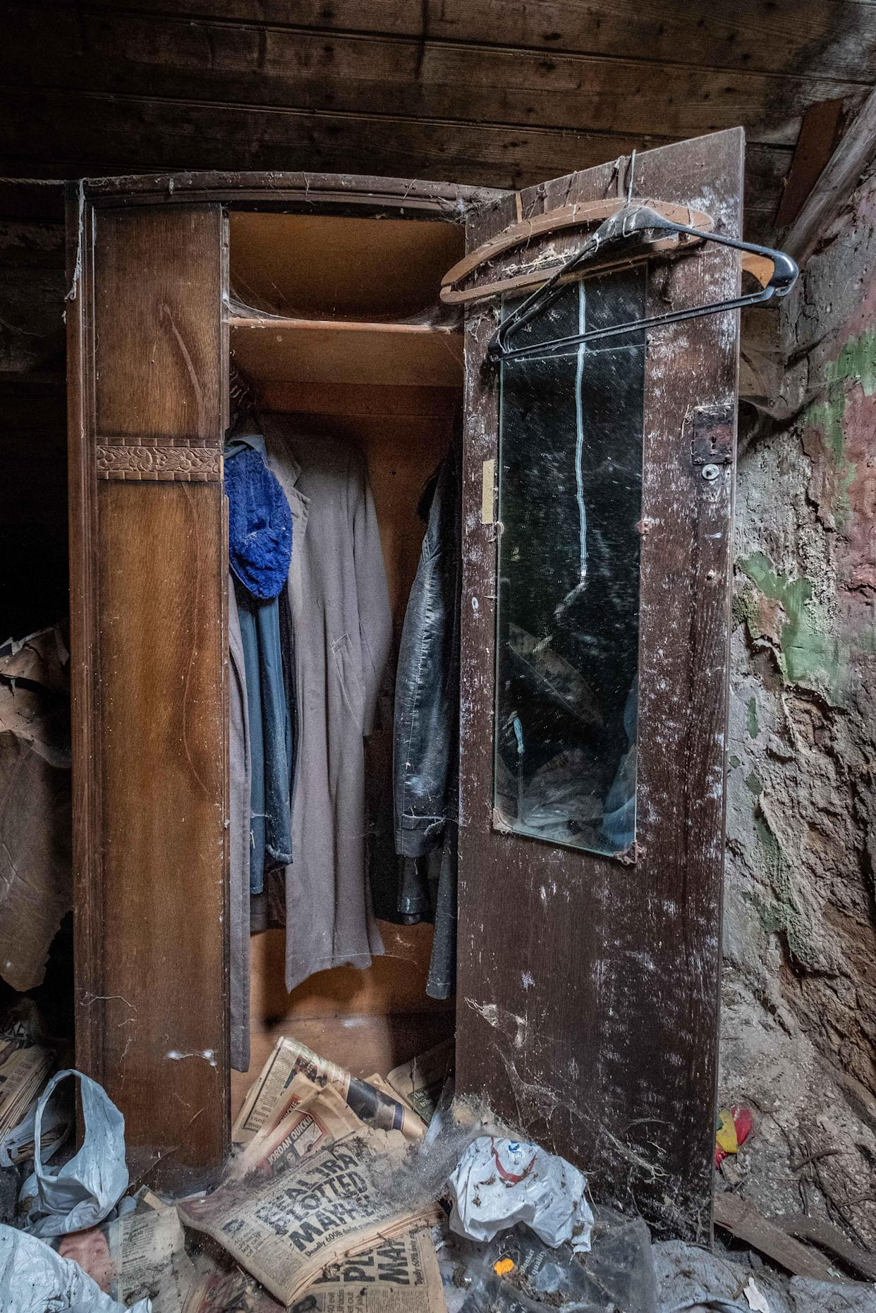 Clothes left in a wardrobe inside an abandoned home in Northern Ireland, March 12, 2018. (Photo: Unseen Decay/Mercury Press/Caters News)