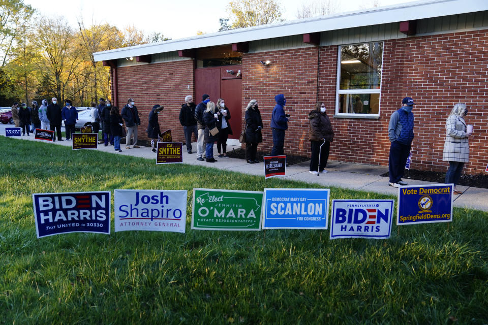FILE - In this Tuesday, Nov. 3, 2020 file photo, people line up outside a polling place to vote in the 2020 general election in the United States in Springfield, Pa. On Thursday, Dec. 31, 2020, The Associated Press reported on stories circulating online incorrectly asserting there were 205,000 more votes than voters in the 2020 election in Pennsylvania. In Pennsylvania, there were nearly 7 million votes cast. The total number of registered voters in 2020 was just over 9 million. (AP Photo/Matt Slocum)