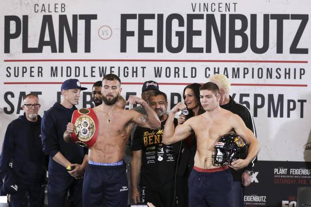 Caleb Plant, front left, and Vincent Feigenbutz, front right, pose Friday, Feb. 14, 2020, during the weigh-in for the IBF super middleweight title in Nashville, Tenn. The fight is scheduled for Saturday, Feb. 15. (AP Photo/Mark Humphrey)