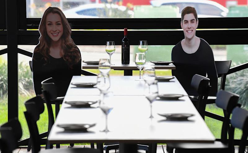 A pair of '2D patrons' at Five Dock Dining in Sydney, Australia. Getty Images