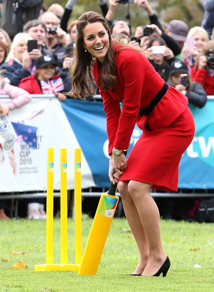 <p></p><p><span>On a three-week tour of Australia and Nwew Zealand, Middleton took part in cricket match while wearing, you guessed it, pumps. On the first official overseas trip with Prince George in 2014, the royal wore a red peplum skirt suit on the pitch with a pair of classic, black heels. <em>(Photo via Getty Images)</em></span> </p><p></p>