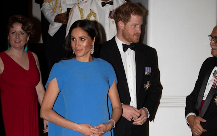 The Duchess of Sussex wore the earrings at a state dinner in Fiji in 2018 - GETTY IMAGES