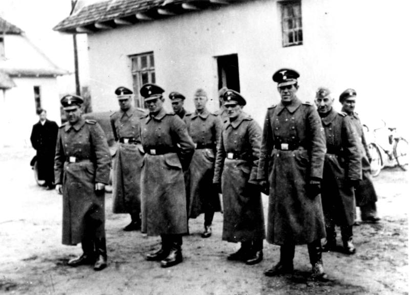 This photo made available by Yad Vashem Photo Archive in Jerusalem shows Nazi guards at Belzec death camp in occupied Poland in 1942.  Samuel Kunz, one of the world's most-wanted Nazi suspects who was under indictment on allegations he was involved in killing hundreds of thousands of Jews at a concentration camp in occupied Poland, has died, a Bonn court said Monday, Nov. 22, 2010. (AP Photo/Yad Vashem Photo Archive)