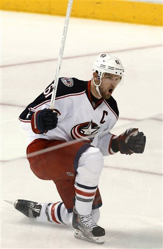 Columbus Blue Jackets' Rick Nash reacts after scoring a goal against the Dallas Stars during the first period of an NHL hockey game Thursday, Dec. 29, 2011, in Dallas. (AP Photo/Tim Sharp)