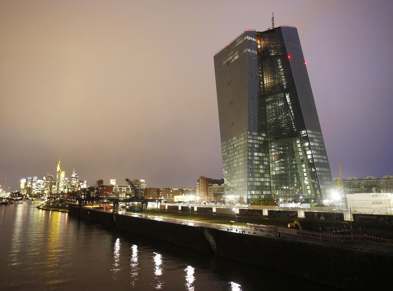 The new headquarters of the European Central Bank (ECB), building at right, is under construction on the water front of the River Main, in Frankfurt, Germany, Friday, Feb. 14, 2014. The ECB is supposed to move into this new building at the end of 2014. The fourth quarter financial growth for 2013 outperformed analysts' expectations and eased some of the pressure on the European Central Bank to loosen its monetary policy. (AP Photo/Michael Probst)
