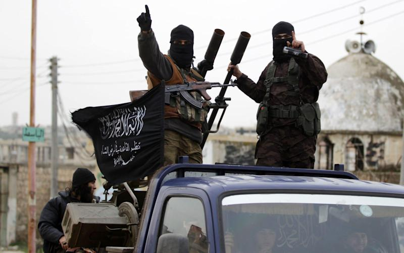 Members of Nusra Front pictured in Syria in 2014, when the group was part of al-Qaeda  - Reuters