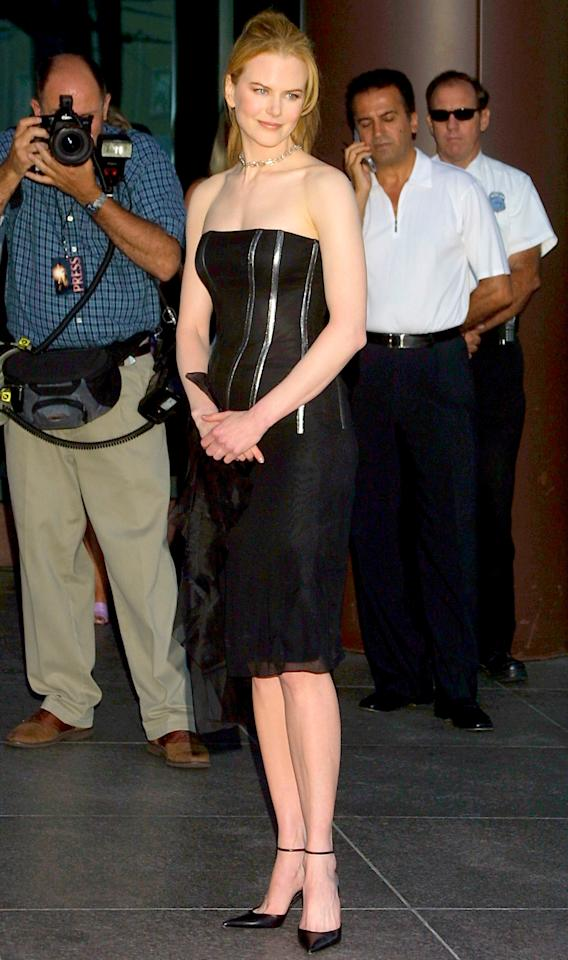 <p>The night before her divorce to Tom Cruise became finalized, Kidman turned heads in this streamlined black bustier dress. Cruise, who had been separated from the actress for six months already, was also there as the film's producer. That's not awkward at all. </p>