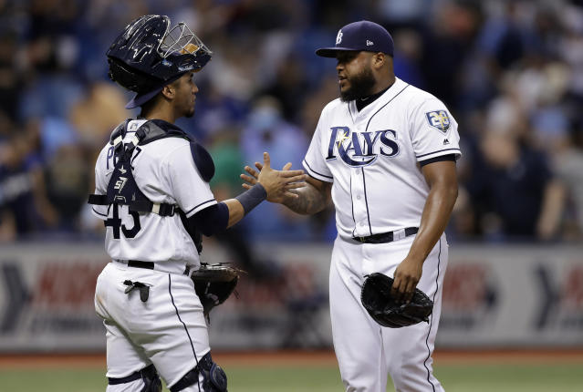 Tampa Bay Rays pitcher Jose Alvarado, right, celebrates with catcher Michael Perez after closing out the Kansas City Royals during a baseball game Monday, Aug. 20, 2018, in St. Petersburg, Fla. (AP Photo/Chris O'Meara)