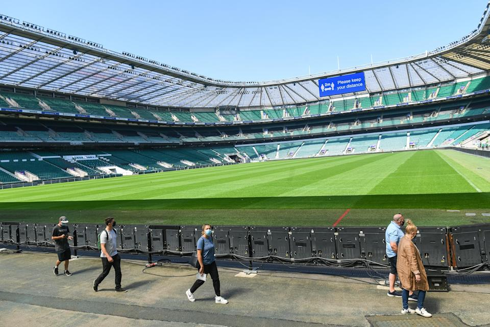 Members of the public arrive to receive a coronavirus vaccination at Twickenham rugby stadium (PA Wire)
