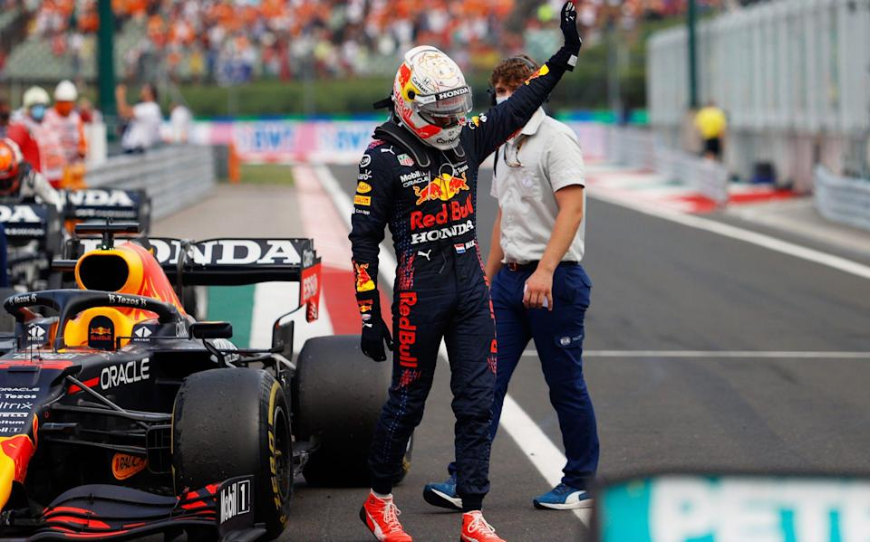Max Verstappen of Netherlands and Red Bull Racing waves to the crowd in parc ferme during the F1 Grand Prix of Hungary at Hungaroring on August 01, 2021 in Budapest, Hungary