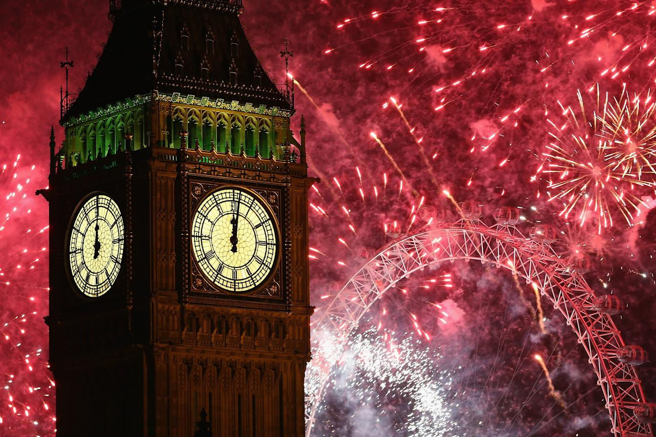 LONDON, ENGLAND - JANUARY 01: Fireworks light up the London skyline and Big Ben just after midnight on January 1, 2014 in London, England. Thousands of people lined the banks of the River Thames in central London to see in the New Year with a spectacular fireworks display. (Photo by Dan Kitwood/Getty Images)
