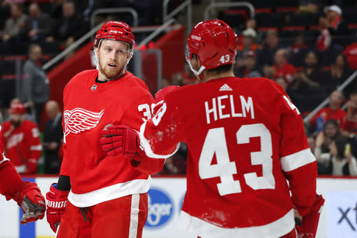 Detroit Red Wings right wing Anthony Mantha (39) celebrates his goal against the Montreal Canadiens with Darren Helm (43) in the second period of an NHL hockey game, Tuesday, Feb. 26, 2019, in Detroit. (AP Photo/Paul Sancya)