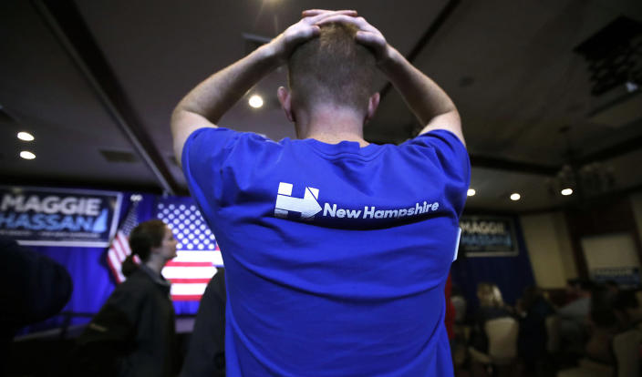 <p>Matt Sanborn of Laconia, N.H., a Boston College student who volunteered for Democratic candidates including Hillary Clinton and New Hampshire Democratic Senate candidate, Gov. Maggie Hassan, rests his hands on the top of his head while watching election returns during an election night rally in Manchester, N.H., Nov. 8, 2016. (Photo: Charles Krupa/AP) </p>