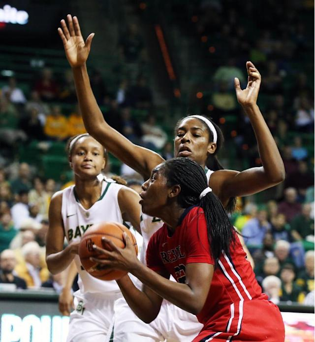 Mississippi's Danielle McCray (22) looks to the basket past Baylor forward Khadijiah Cave, right rear, during the first half of an NCAA college basketball game, Wednesday, Dec. 18, 2013, in Waco, Texas. (AP Photo/Waco Tribune Herald, Rod Aydelotte)
