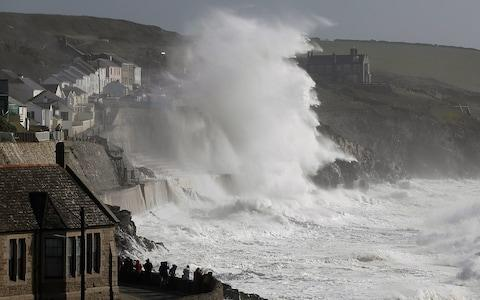 Huge waves whipped up by Hurricane Ophelia batter the coast at Porthleven in Cornwall - Credit: APEX