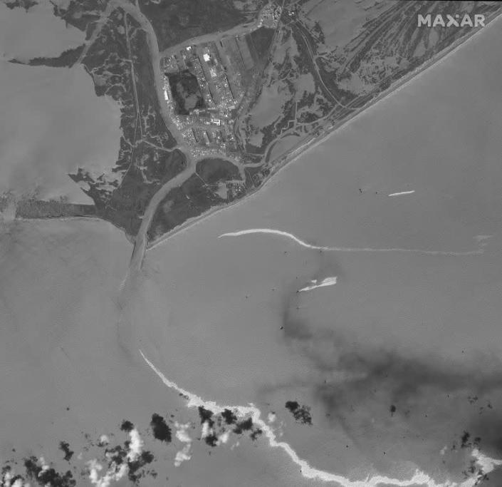 A satellite image shows an overview of the port and an oil slick following Hurricane Ida, Port Fourchon, Louisiana