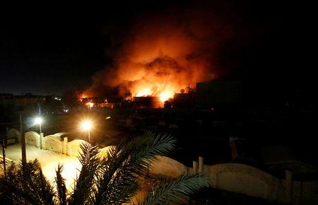 FILE PHOTO: Smoke rises from the Governorate Council building of Basra