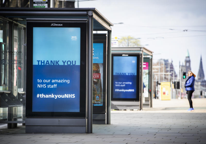 Poster thanking the NHS displayed on the side of a bus stop shelters in Princes Street, Edinburgh, as the UK continues in lockdown to help curb the spread of the coronavirus.
