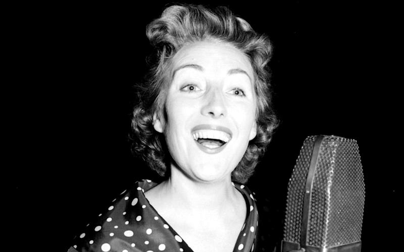 Dame Vera rehearsing in London for her radio show in 1956 - PA