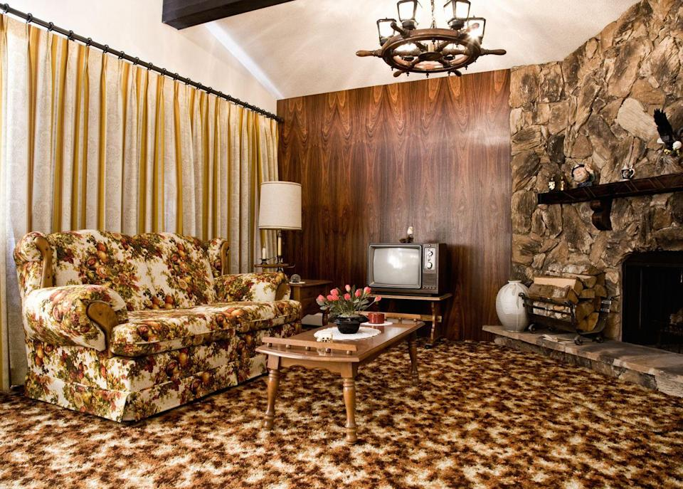 <p>Made of rough rock and usually taking up a whole wall, this design trend wouldn't have looked out of place in a hunting lodge.</p>