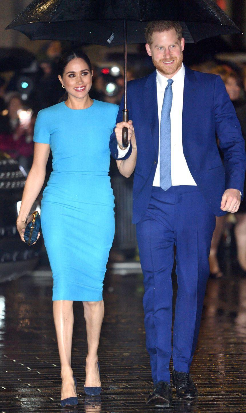 <p>A blue, bodycon dress by Victoria Beckham was the outfit du jour for the awards ceremony. Meghan paired the ensemble with a chic, low ponytail and her signature centre parting.</p>
