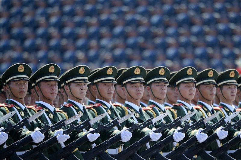Chinese soldiers marching in formation during a 2015 parade at Tiananmen Square in Beijing (AFP Photo/WANG Zhao)