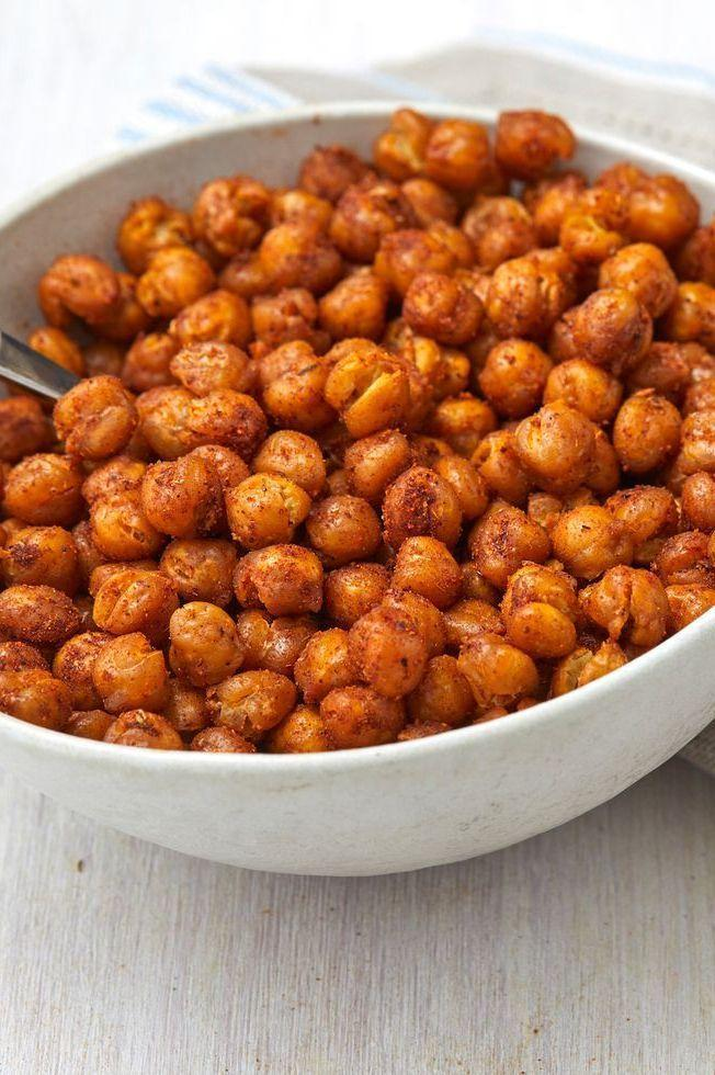 """<p>Chickpeas are good for so much more than just <a href=""""https://www.delish.com/uk/cooking/recipes/a34092710/best-homemade-hummus-recipe/"""" rel=""""nofollow noopener"""" target=""""_blank"""" data-ylk=""""slk:creamy homemade hummus"""" class=""""link rapid-noclick-resp"""">creamy homemade hummus</a>. (Though, that's definitely a good use of them!) They also make for a particularly good salty snack, and are infinitely adaptable based on what you've got in your spice cabinet.</p><p>Get the <a href=""""https://www.delish.com/uk/cooking/recipes/a34665040/roasted-chickpeas-recipe/"""" rel=""""nofollow noopener"""" target=""""_blank"""" data-ylk=""""slk:Roasted Chickpeas"""" class=""""link rapid-noclick-resp"""">Roasted Chickpeas</a> recipe.</p>"""