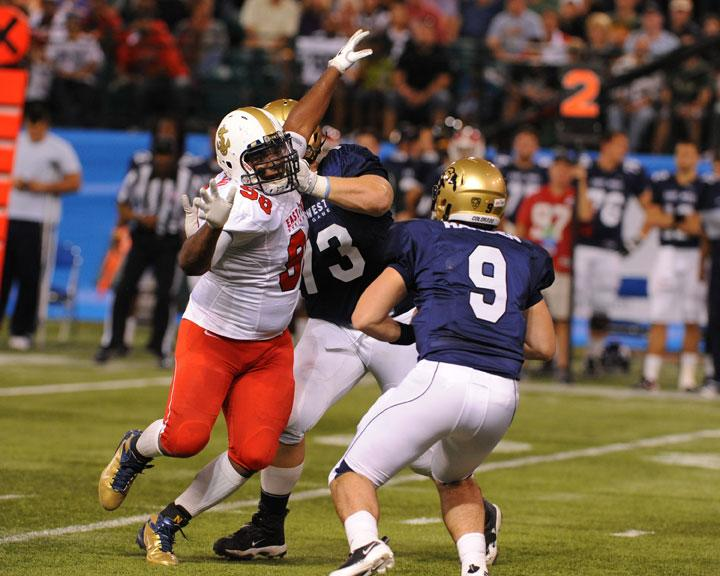 ST. PETERSBURG, FL - JANUARY 21: Defemsive lineman Jabaree Tuani #98 of the U. S. Naval Academy Midshipmen pressures quarterback Tyler Hansen of the University of Colorado Buffaloes during the 87th annual East-West Shrine game January 21, 2012 at Tropicana Field in St. Petersburg, Florida. (Photo by Al Messerschmidt/Getty Images)