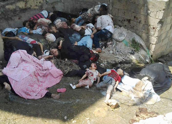 This citizen journalism image provided by Edlib News Network, ENN, and released on Saturday, May 4, 2013, which has been authenticated based on its contents and other AP reporting, shows dead bodies in Banias, Syria. On Thursday, July 25, 2013, Secretary-General Ban Ki-moon raised the death toll in Syria's civil war to more than 100,000, up from nearly 93,000 just over a month ago. (AP Photo/Edlib News Network ENN)