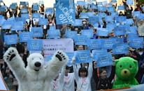 Tens of thousands marched across Australia Sunday on a third day of worldwide rallies as pressure mounts on global leaders to strike a pact on slashing greenhouse gases at crunch talks in still-shaken Paris.