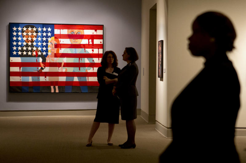 """Faith Ringgold's painting, """"The Flag is Bleeding,"""" is one of her works on display during a media preview of her exhibition, """"American People, Black Light: Faith Ringgold's Paintings of the 1960s"""" at the National Museum of Women in the Arts in Washington on Wednesday, June 19, 2013. Ringgold explains her """"confrontational art"""" _ vivid paintings whose themes of race, gender, class and civil rights were so intense that for years, no one would buy them. """"I didn't want people to be able to look, and look away, because a lot of people do that with art,"""" Ringgold said. """"I want them to look and see. I want to grab their eyes and hold them, because this is America."""" (AP Photo/Jacquelyn Martin)"""