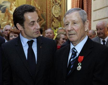 France's President Nicolas Sarkozy poses with French former soccer legend Raymond Kopa in Paris