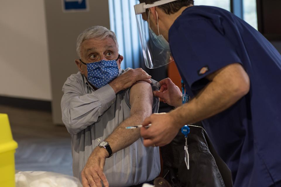 <p>An Elderly patient receives the covid jab at The Hive at Barnet FC</p>Harrow Health