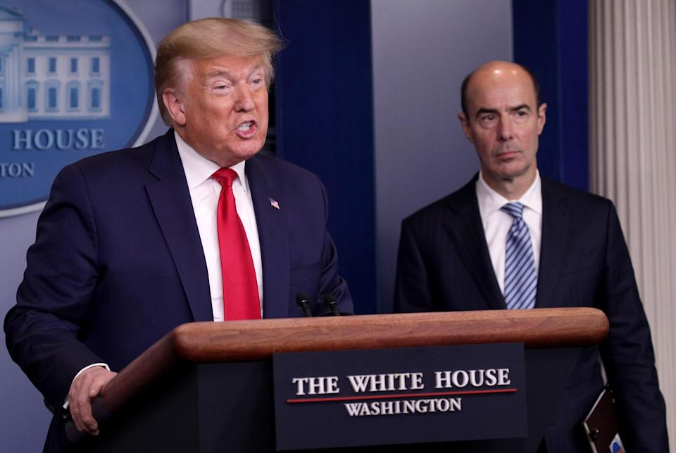 """Labor Secretary Eugene Scalia, right, says the change will allow investors to """"gain access to alternative investments"""". (Alex Wong/Getty Images)"""