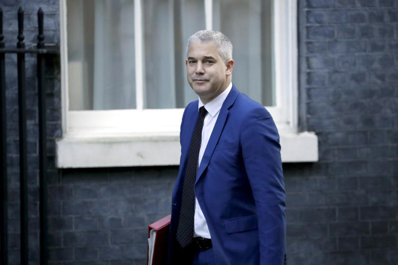 Britain's Secretary of State for Exiting the European Union Steve Barclay arrives for a cabinet meeting at 10 Downing Street in London, Tuesday, Oct. 22, 2019. British Prime Minister Boris Johnson's European Union divorce bill faces two votes Tuesday, with lawmakers first being asked to approve it in principle, followed by a vote on the government's schedule for debate and possible amendments. (AP Photo/Matt Dunham)