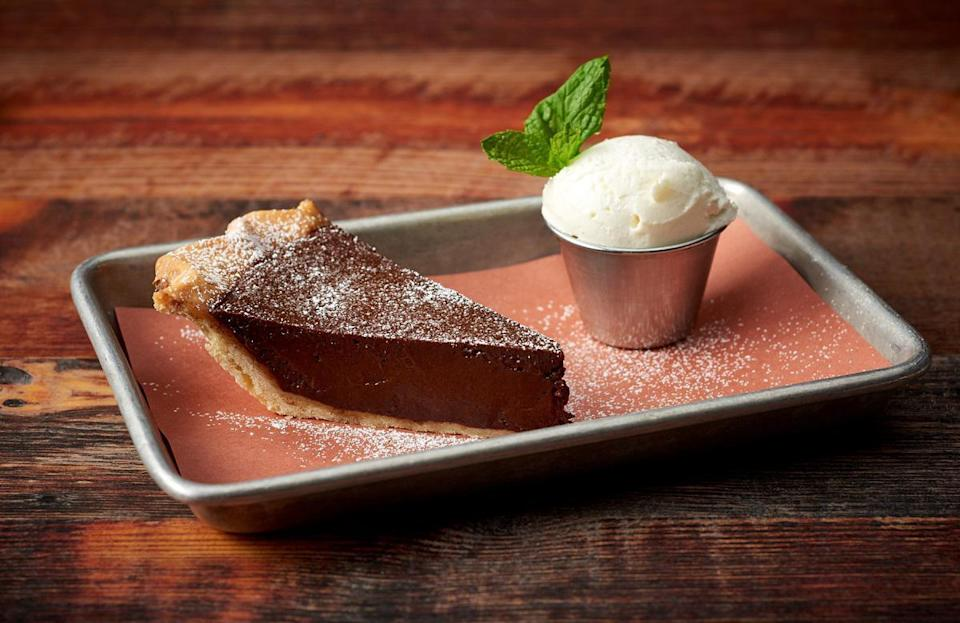 "<p>While chess pie is a beloved dessert all throughout the South, it first appeared in an 1824 cookbook ""The Virginia Housewife"" under the title ""transparent pudding,"" marking it as the state's most iconic dessert.</p> <p><a href=""https://www.thedailymeal.com/best-recipes/chocolate-chess-pie?referrer=yahoo&category=beauty_food&include_utm=1&utm_medium=referral&utm_source=yahoo&utm_campaign=feed"" rel=""nofollow noopener"" target=""_blank"" data-ylk=""slk:For the Chocolate Chess Pie recipe, click here"" class=""link rapid-noclick-resp"">For the Chocolate Chess Pie recipe, click here</a>.</p>"