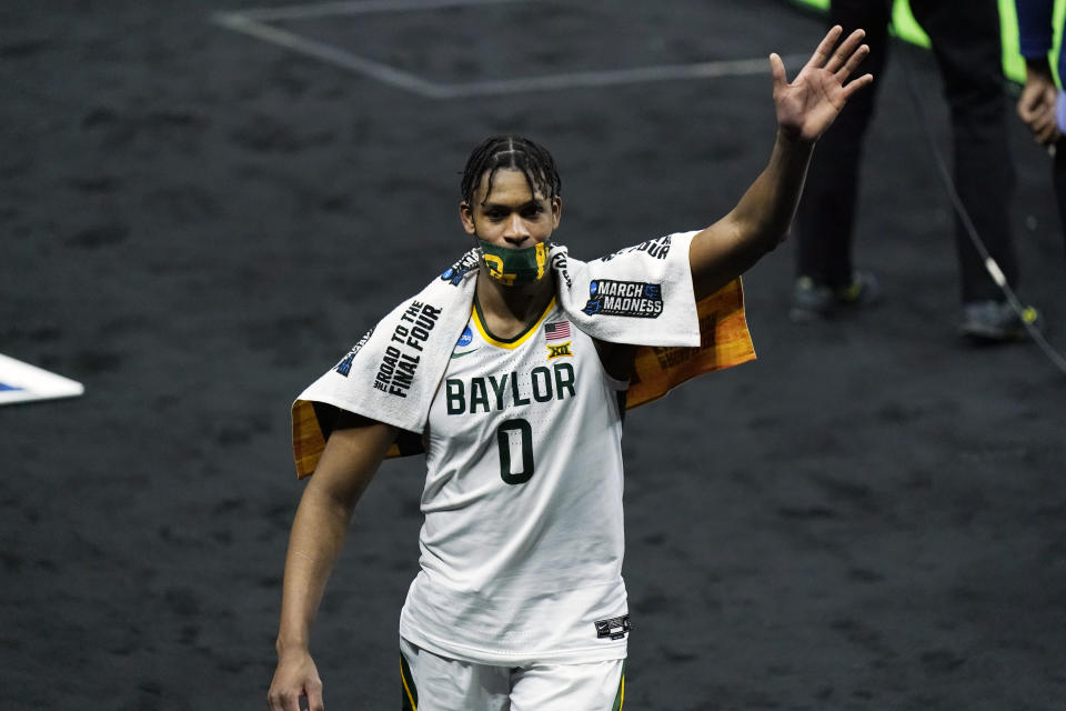 Baylor's Flo Thamba waves to fans as he leaves the court after Baylor defeated Hartford in the first round of the NCAA tournament. (AP Photo/Mark Humphrey)