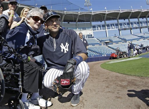 New York Yankees shortstop Derek Jeter poses for a photograph with 85-year-old New York Yankees fan Annie Economy from Eagle Rock, Va., before a spring training baseball game in Tampa, Fla., Friday, March 15, 2013. (AP Photo/Kathy Willens)