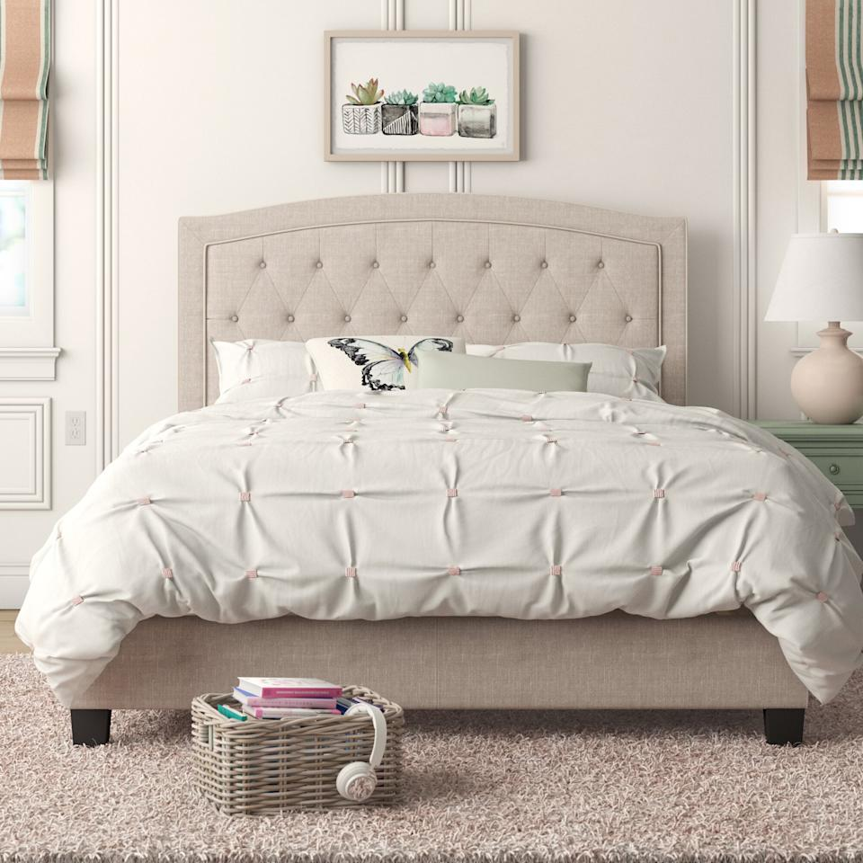 """<p>Upgrade your bedroom with the <a href=""""https://www.popsugar.com/buy/Pascal-Tufted-Upholstered-Low-Profile-Standard-Bed-581684?p_name=Pascal%20Tufted%20Upholstered%20Low%20Profile%20Standard%20Bed&retailer=wayfair.com&pid=581684&price=211&evar1=casa%3Aus&evar9=47546600&evar98=https%3A%2F%2Fwww.popsugar.com%2Fhome%2Fphoto-gallery%2F47546600%2Fimage%2F47546680%2FPascal-Tufted-Upholstered-Low-Profile-Standard-Bed&list1=shopping%2Cfurniture%2Chome%20shopping%2Cwayfair&prop13=mobile&pdata=1"""" rel=""""nofollow"""" data-shoppable-link=""""1"""" target=""""_blank"""" class=""""ga-track"""" data-ga-category=""""Related"""" data-ga-label=""""https://www.wayfair.com/furniture/pdp/andover-mills-pascal-tufted-upholstered-low-profile-standard-bed-w001104054.html"""" data-ga-action=""""In-Line Links"""">Pascal Tufted Upholstered Low Profile Standard Bed</a> ($211, originally $1,000).</p>"""