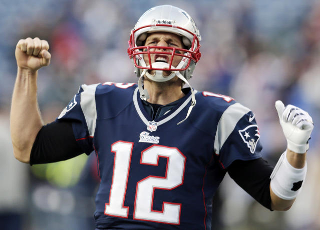 New England Patriots quarterback Tom Brady (12) reacts to the crowd as he takes the field prior to an NFL football game against the Indianapolis Colts at Gillette Stadium in Foxborough, Mass., Sunday, Nov. 18, 2012. (AP Photo/Charles Krupa)