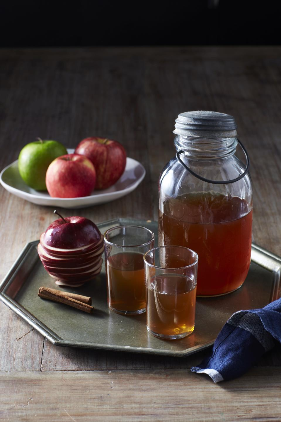 """<p>A delicious apple cider cocktail just so happens to be the perfect autumn drink.</p> <p><a href=""""https://www.myrecipes.com/recipe/apple-pie-moonshine"""" rel=""""nofollow noopener"""" target=""""_blank"""" data-ylk=""""slk:Apple Pie Moonshine Recipe"""" class=""""link rapid-noclick-resp"""">Apple Pie Moonshine Recipe</a></p>"""