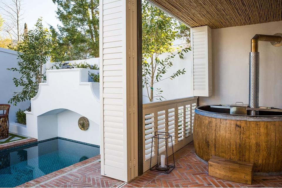 """<strong><a href=""""https://www.tripadvisor.com/Hotel_Review-g469391-d593969-Reviews-Akademie_Street_Boutique_Hotel-Franschhoek_Western_Cape.html"""" target=""""_blank"""" rel=""""noopener noreferrer"""">This boutique hotel</a></strong> features nine suites in the heart of the Cape wine lands. There are four swimming pools, four gardens and is located within walking distance of the city's best restaurants."""