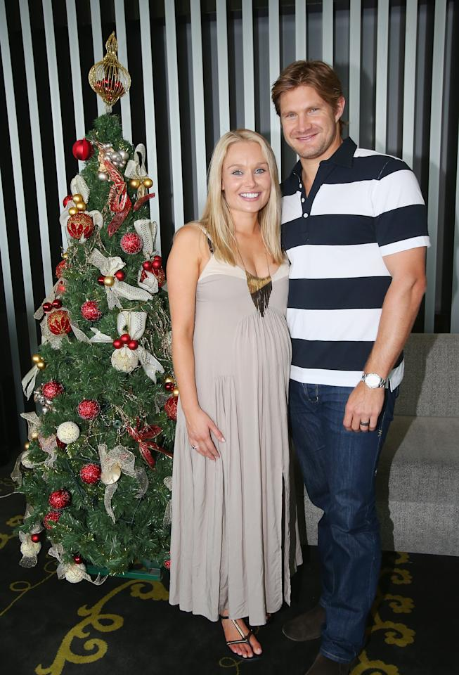 MELBOURNE, AUSTRALIA - DECEMBER 25:  Shane Watson of Australia and his pregnant wife Lee Furlong pose next to a Christmas tree ahead of a Cricket Australia Christmas Day lunch at Crown Entertainment Complex on December 25, 2012 in Melbourne, Australia.  (Photo by Scott Barbour/Getty Images)