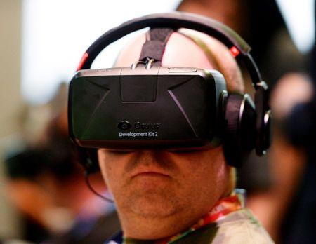 FILE PHOTO - Attendee tries Oculus Rift Development Kit 2 headset at Electronic Entertainment Expo in Los Angeles