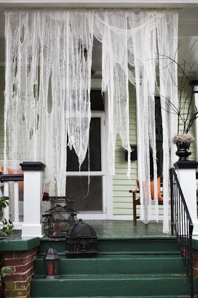 This undated photo provided by Brian Patrick Flynn shows a haunted-house entryway, with ripped pieces of cheesecloth that were soaked in weak tea, created by designer, Brian Patrick Flynn for HGTV.com, in Atlanta. Once dried, pieces can be draped from staples or small nails. Start the party before your guests even enter your home. (AP Photo/Brian Patrick Flynn/HGTV.com, Scripps Networks Interactive/Sarah Dorio)