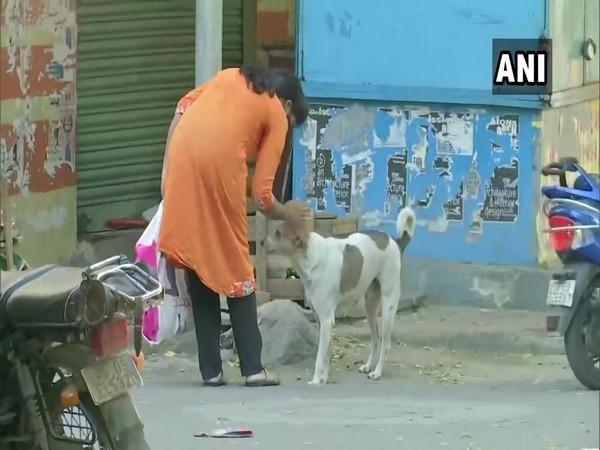 Shailaja with a stray dog in her locality. (Photo/ANI)
